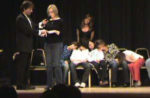 Hypnotized Volunteer is missiing the number 6 and counts 11 fingers!