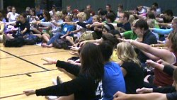 High School stage hypnosis volunteers experience the power of the mind with a light induction technique.